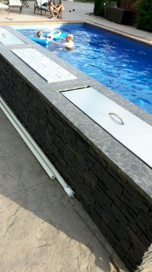 Stamped swimming pool wall