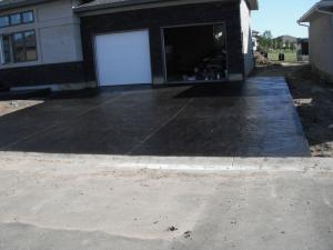 Dark stamped driveway decorative concrete