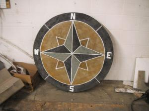 Decorative concrete compass inlay for driveway