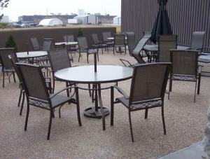 Exposed aggregate concrete patio with table