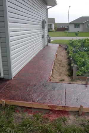 Red stamped decorative concrete sidewalk