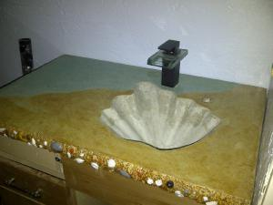 Seashell ocean themed concrete countertop vanity