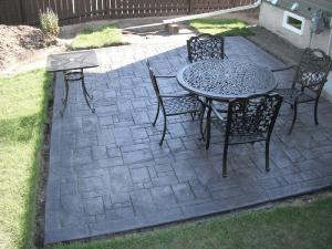Stamped concrete decorative patio with table