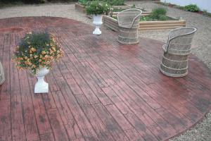 Wood plank decorative concrete stamped backyard